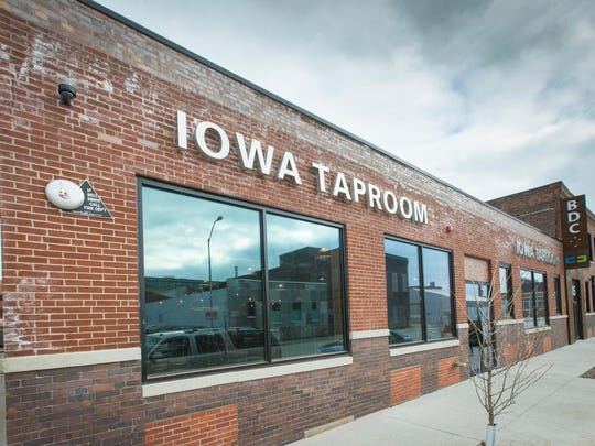 Iowa Taproom - The 7,200-square-foot bar and restaurant in the former Dilley Manufacturing building will feature a patio and a deck in the alleyway. A 64 linear-foot bar wraps around a silo dispensing brews in a half hexagon shape covered with an 1880s countertop salvaged from a bar in Jewell, Iowa, a theme that echoes throughout the space that uses furnishings made in Iowa or materials salvaged in the state.