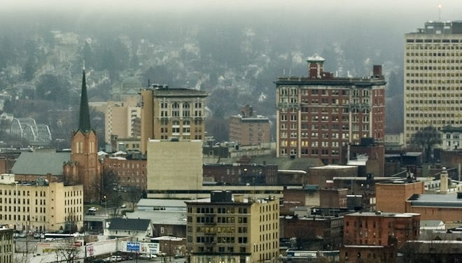 Morning fog hangs over downtown Binghamton.