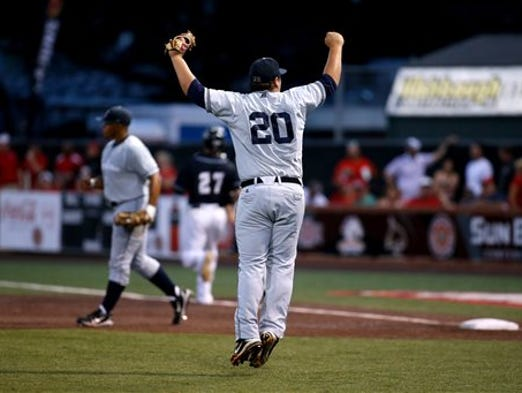 Jackson State pitcher Alexander Juday reacts after his team won an NCAA college baseball tournament regional game against Louisiana-Lafayette in Lafayette, La., Friday, May 30, 2014.  (AP Photo/Jonathan Bachman)