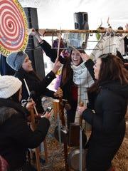 Lauren Kaiser of Milwaukee holds the stumpf fiddle