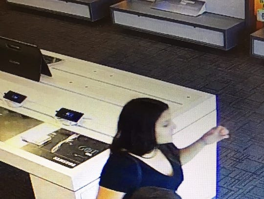 Surveillance photo of a cellphone theft suspect in