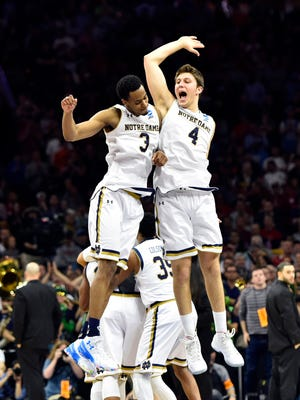 Notre Dame Fighting Irish forward V.J. Beachem (3) and forward Matt Ryan (4) celebrate.