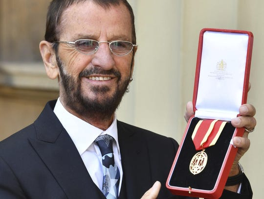 Musician Ringo Starr, poses for photographers after