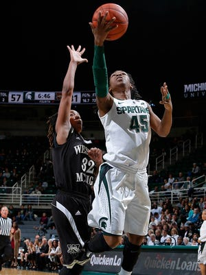 Michigan State's Akyah Taylor (45) puts up a layup against Western Michigan's LaTondra Brooks Sunday, Nov. 15, 2015, in East Lansing, Mich. Michigan State won 78-40.