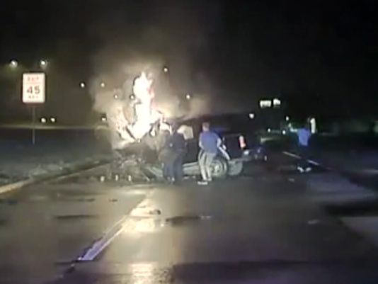 Dashcam video shows Mesquite, Texas officers pulling driver from burning car.
