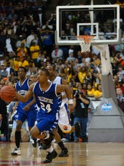 Chillicothe's Anthony Hitchens drives down the court in the final 5 seconds of overtime before passing the ball to Ray Chambers for the winning basket Saturday at the 2008 Division II State Championship at the Jerome Schottenstein Center.