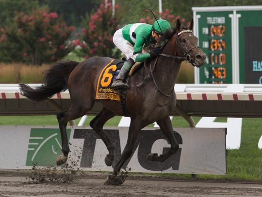 Exaggerator, with jockey Kent Desormeaux aboard, roars to victory Sunday in the $1 million Grade I betfair.com Haskell Invitational at Monmouth Park
