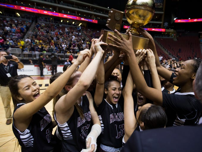 Hamilton's Payton Whitmore lifts the trophy with her