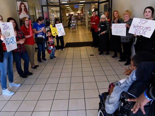 J.C. Penney employees welcome 16-year-old Mutoni Jolie and her family Saturday for a shopping spree from the Make-A-Wish Foundation.
