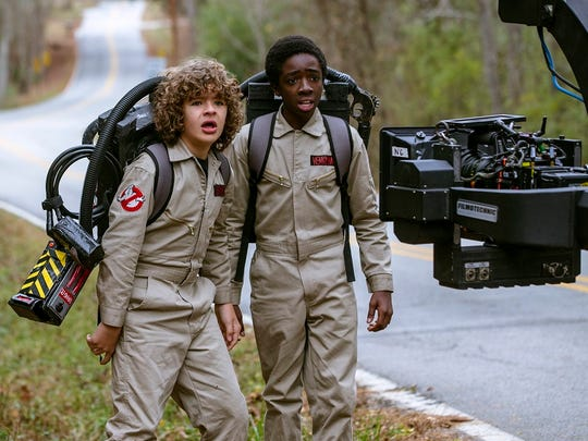 "Cast members Gaten Matarazzo, left, and Caleb McLaughlin are seen with a camera during the making of ""Stranger Things 2,"" which debuts Oct. 27 at Netflix."