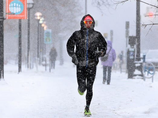 A jogger makes his way north along State Street during