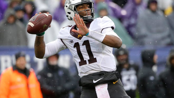 In this Nov. 18, 2017, file photo, Minnesota quarterback Demry Croft looks to pass against Northwestern during the first half of an NCAA college football game in Evanston, Ill. A school official says University of Minnesota starting quarterback Demry Croft will leave the Gophers. University spokesman Paul Rovnak texted the St. Paul Pioneer Press on Sunday night, Nov. 26, 2017, that Croft asked coach P.J. Fleck for his release after Saturday's 31-0 loss to Wisconsin. (AP Photo/Nam Y. Huh, File)