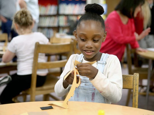 View Ridge Elementary Arts Academy kindergartener Maleah Gaines-Davis works on an craft project Tuesday night.
