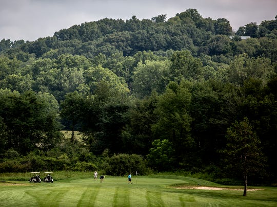 Golfers enjoy a morning at Raccoon International Golf