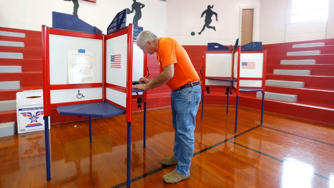 Jim Young votes at Faught Administration Center in Nixa on Tuesday, April 5, 2016.