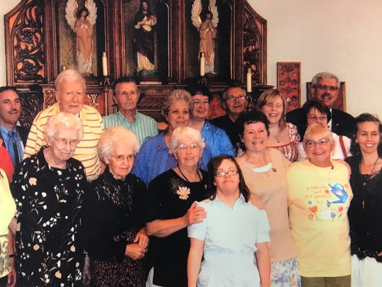 """This photo shows several great-nieces and great-nephews of Father Solanus Casey, as well as cousins of the renowned Capuchin friar who travelled from Ireland to the Capuchin monastery on Detroit's east side. They gathered there in front of a chapel altar in 2007, when the Capuchins commemorated the 50th anniversary of Solanus Casey's death in 1957.  Several of them are returning to Detroit for the Catholic beatification ceremony declaring him """"Blessed Solanus"""" on Nov. 18, 2017."""
