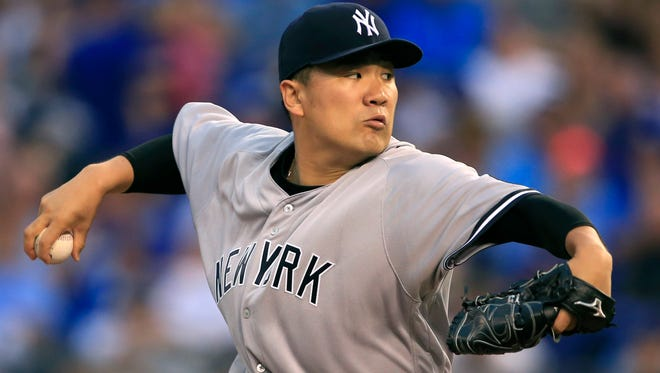 New York Yankees starting pitcher Masahiro Tanaka delivers to a Kansas City Royals batter during the first inning of a baseball game at Kauffman Stadium in Kansas City, Mo., Tuesday, Aug. 30, 2016.