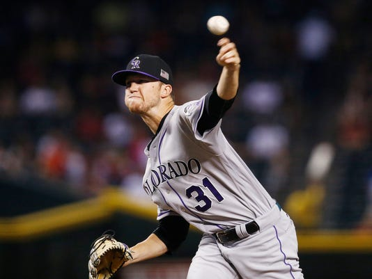Colorado Rockies' Kyle Freeland throws a pitch against the Arizona Diamondbacks during the first inning of a baseball game, Monday, Sept. 11, 2017, in Phoenix. (AP Photo/Ross D. Franklin)
