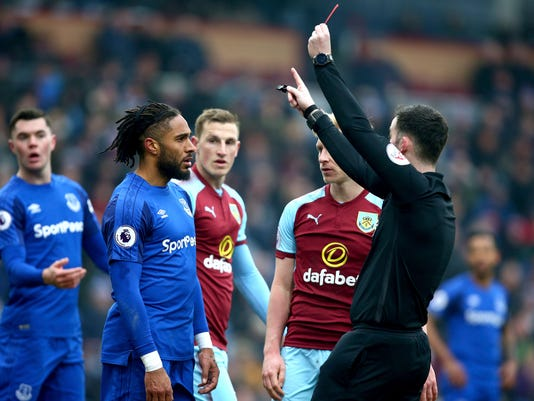 Everton's Ashley Williams, 2nd left, receives a red card from Referee Chris Kavanagh during the match against Burnley during their English Premier League soccer match at Turf Moor, Burnley, England, Saturday March 3, 2018. (Dave Thompson/PA via AP)