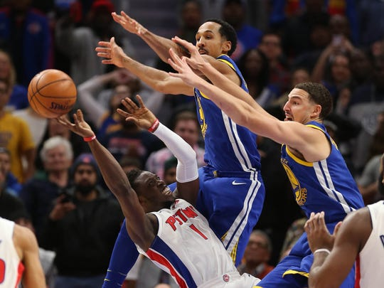 Reggie Jackson misses a last-second shot in the fourth quarter against Warriors guards Shaun Livingston, left, and Klay Thompson in the Pistons' 102-98 loss on Dec. 8, 2017 at Little Caesars Arena.