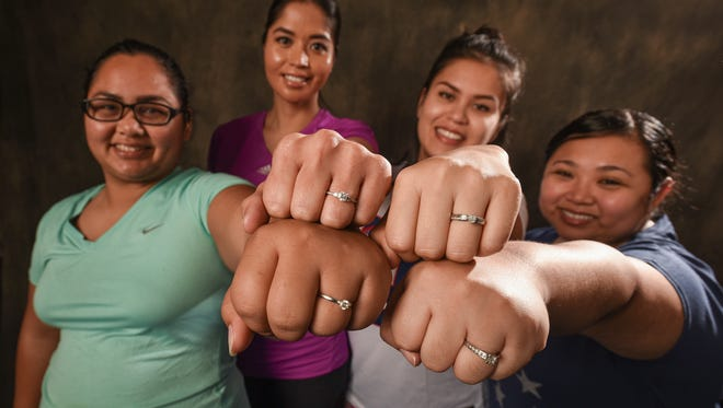 Bridal Boot Camp contestants display the power of the rings during a photo shoot at the Pacific Daily News studio on Friday, Dec. 30, 2016. From left: Holi Tainatongo, Gennie-May Whitt, Aletka Iyechad and Jerena Eustaquio.