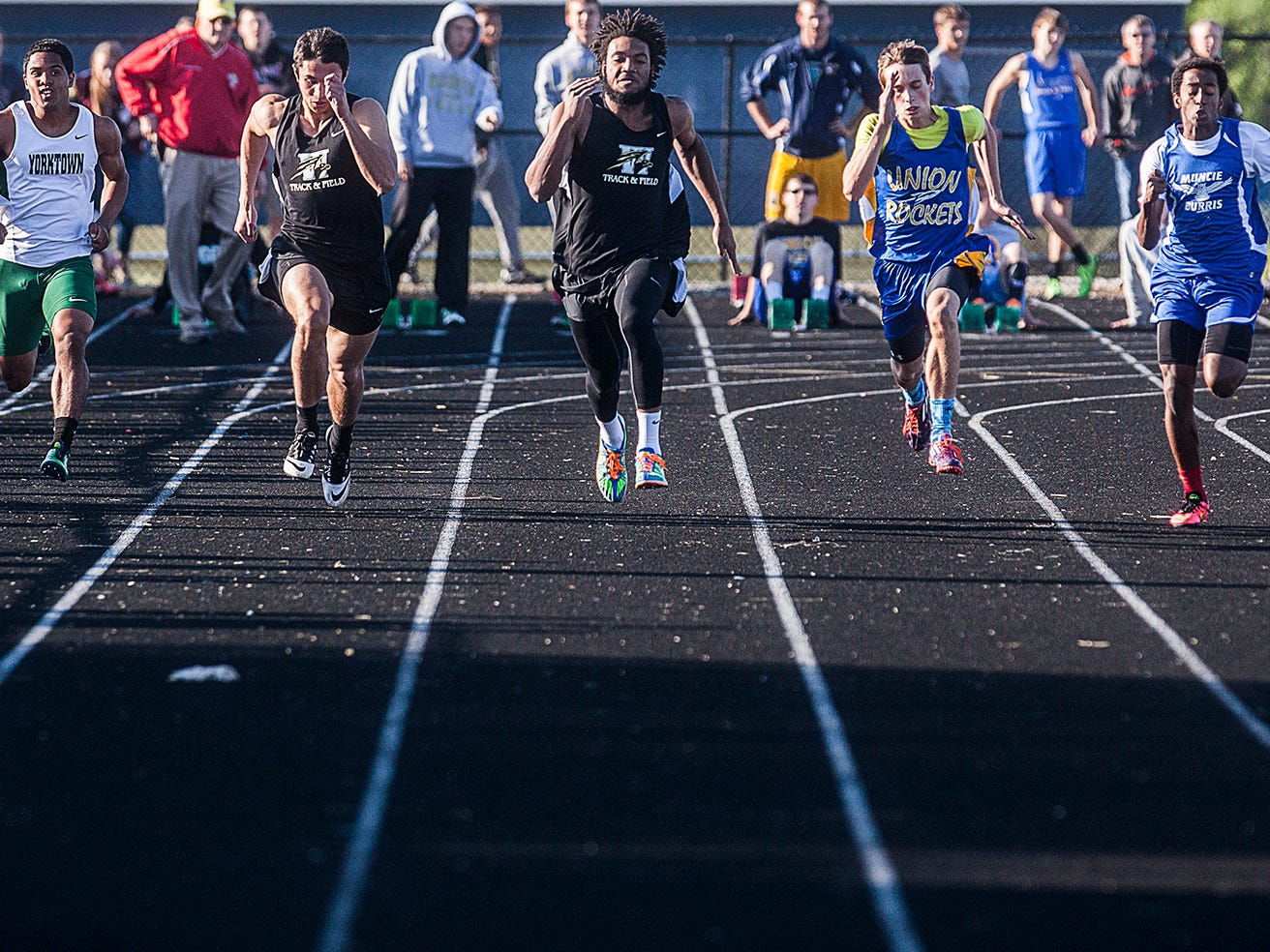 Winchester's Kiante Enis takes his lead in the 100 at the Central track sectional on Thursday at Delta.