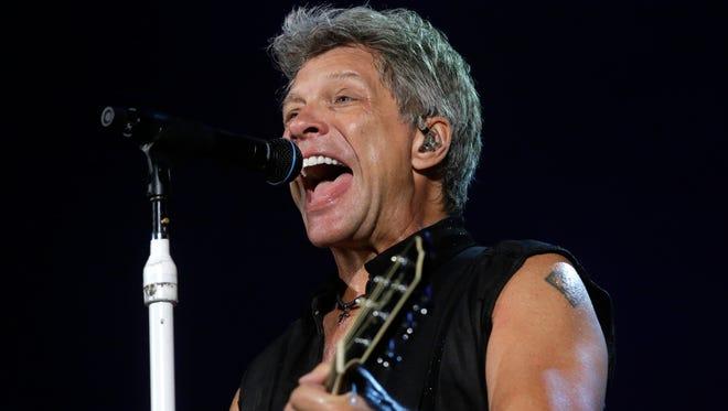 "In this Sept. 11, 2015 file photo, Bon Jovi's lead singer Jon Bon Jovi performs during their ""Bon Jovi Live!"" concert at Gelora Bung Karno Stadium in Jakarta, Indonesia, on their Asia tour."