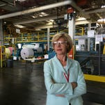 U.S. Sen. Tammy Baldwin, D-Wis., takes a tour of Appvion's plant Monday during her visit to support the Export-Import Bank. Companies like Appvion benefit from the exports the bank helps facilitate.