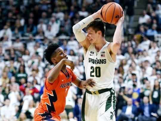 Michigan State's Matt McQuaid, right, is pressured