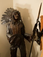 Charlie DeVille's American Indian statue stands in