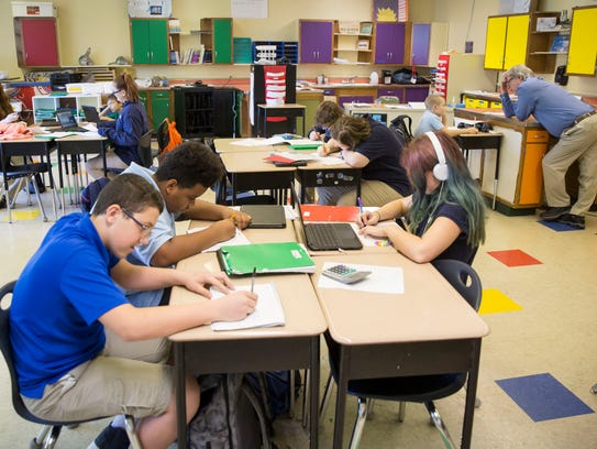 Students at Inspire Academy work on different assignments