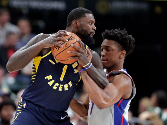 Pistons forward Stanley Johnson (7) fouls Pacers guard Lance Stephenson (1) during the first half on Friday, Dec. 15, 2017, in Indianapolis.