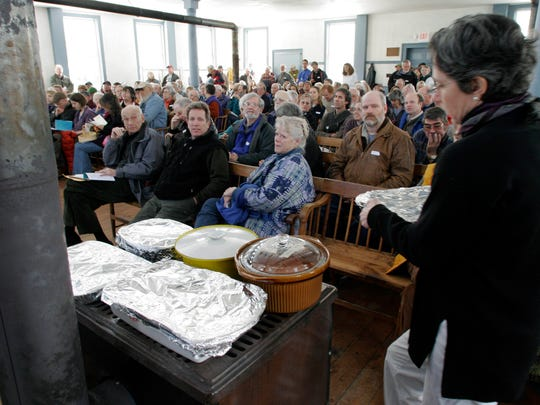In this March 7, 2006, photo, food warms on the wood stove during town meeting in Strafford.