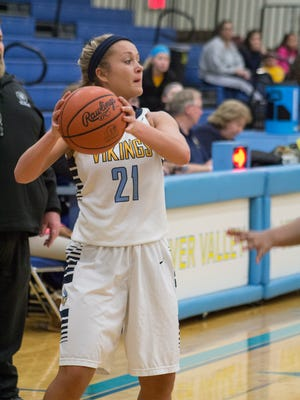 River Valley's Kendall Stuckman looks to make a pass during a 70-30 sectional win over Columbus South. The senior was named All-Ohio along with junior teammate Morgan Lott.