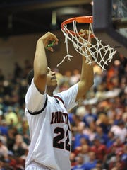 Park Tudor's Trevon Bluiett, 22, cuts down a piece of the net after the Park Tudor Panthers defeated the Forest Park Rangers 57-45 in the 2A Semi-State game at Seymour, Saturday March 19, 2011.  Joe Vitti / The Star <b>03/24/2011 - N01 - NORTHINDY - 1ST - THE INDIANAPOLIS STAR</b><br />Freshman Trevon Bluiett has been a key newcomer for Park Tudor this year. A graduate of coach Ed Schilling's Champions Academy, Bluiett averages 13.7 points a game.