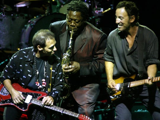 Nils Lofgren, Clarence Clemons and Bruce Springsteen onstage at the Rising Tour kickoff at the Meadowlands arena in 2002.