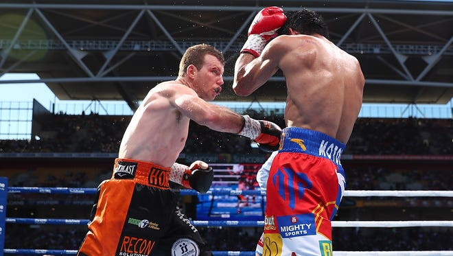 Jeff Horn and Manny Pacquiao exchange punches