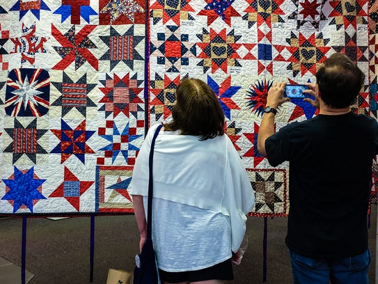 Visitors at the 9/11 World Trade Center Memorial Quilt