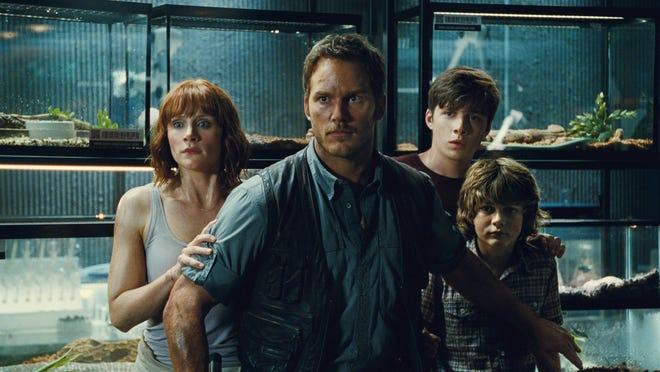 "Bryce Dallas Howard, left, Nick Robinson and Ty Simpkins hide behind protagonist Chris Pratt in the blockbuster smash ""Jurassic World."" Tony McFarr, who grew up on Merritt Island, played Pratt's stunt double in the movie."