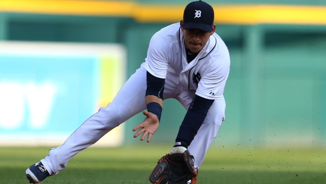 Tigers shortstop Jose Iglesias throws out Cubs designated hitter Mike Baxter during the second inning of the Tigers' 12-3 loss Wednesday at Comerica Park.