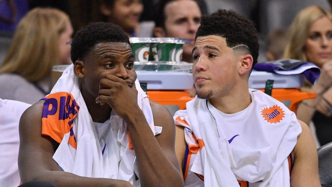 Phoenix Suns forward Danuel House Jr. (left) and Phoenix Suns guard Devin Booker look on against the Houston Rockets during the second half at Talking Stick Resort Arena.
