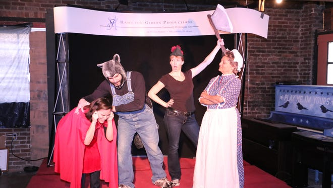 The Wolf (Titus Himmelberger) pounces on Little Red Ridinghood (Natalie Hallead) as The Woodsman (Maia Stam) raises his ax and Grandma Stinkyfeet (Yolie Canales) looks on.