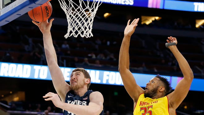 Xavier Musketeers forward Sean O'Mara (54) throws up a shot ahead of Maryland Terrapins forward Damonte Dodd (35) in the first half of the NCAA Tournament First Round game between the Maryland Terrapins and the Xavier Musketeers at the Amway Center in Orlando, Fla., on Thursday, March 16, 2017. At the half, Maryland led Xavier 36-35.