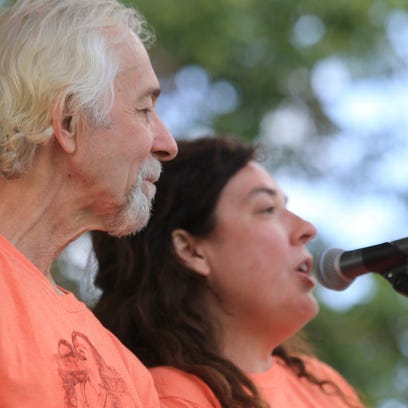 Tim and Lisa Cretsinger make announcements at the 2015 Groovefest Music and Art Festival in Cedar City. Tim only spoke briefly during the festival due to complications from thoat cancer.