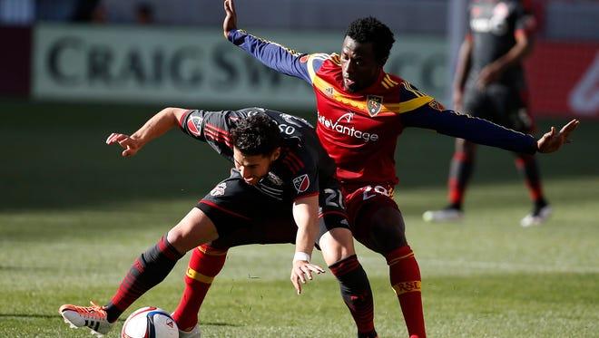 Toronto FC midfielder Jonathan Osorio and Real Salt Lake defender Abdoulie Mansally battle for the ball at Rio Tinto Stadium.