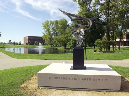 "The sculpture titled ""The Optimist"" by Don Gummer near the Henderson Fine Arts Center on the community college campus Wednesday. The dedication and unveiling of the work, purchased by the Ohio Valley Art League, was held in September 2001."