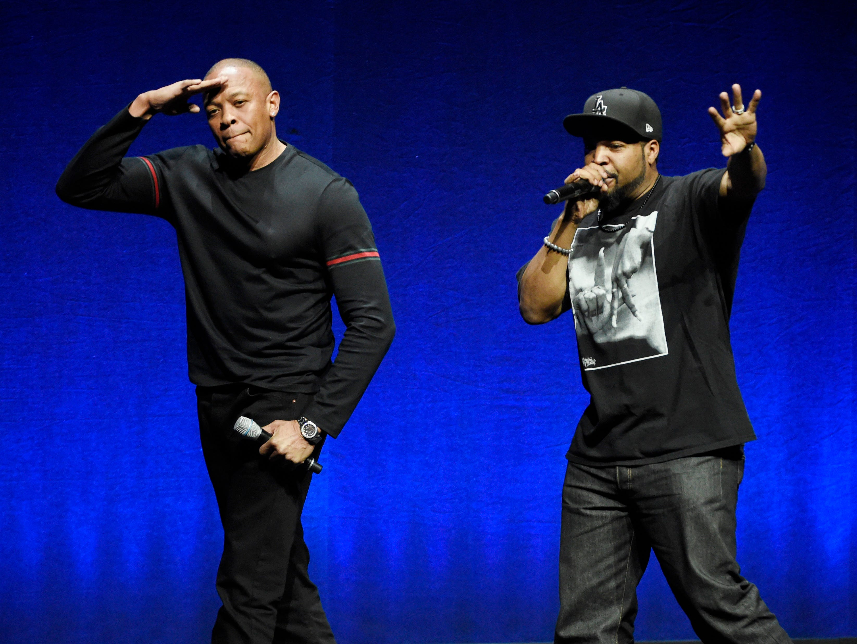 """N.W.A. members Dr. Dre, left, and Ice Cube, two of the subjects of the upcoming biographical drama """"Straight Outta Compton,"""" salute the crowd after speaking at the Universal Pictures presentation during CinemaCon 2015 at Caesars Palace on Thursday, April 23, 2015, in Las Vegas. (Photo by Chris Pizzello/Invision/AP)"""
