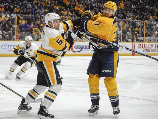 The Penguins' David Warsofsky struggles with the Predators'