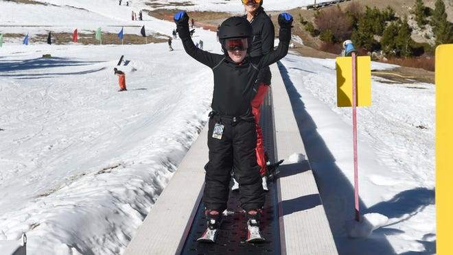 From 2014: Cole Rice, 7, of Reno and his mom Carolyn were among skiers and boarders to show up for an early opening at Mt. Rose.