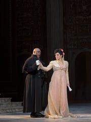 : Scarpia (Gordon Hawkins) ensnares Tosca (Evelina